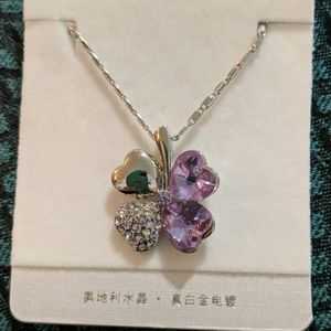 Beautiful purple 4 leaf clover 18 kgp silver chain